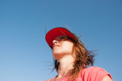 Attractive girl with a baseball cap. Girl wearing a baseball cap from frog perspective Stock Photos