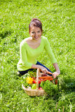 Attractive girl with a basket of fruit and vegetables Stock Photography