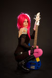 Attractive girl with bass guitar. Isolated on black background Royalty Free Stock Photo