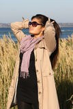 Attractive girl in beige autumn coat Stock Image