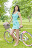Attractive girl  with bicycle Royalty Free Stock Image