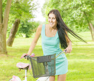 Attractive girl with bicycle Stock Photography