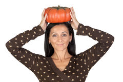 Attractive girl with a big pumpkin Stock Photography