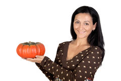 Attractive girl with a big pumpkin Royalty Free Stock Photo