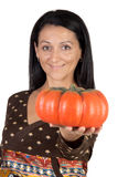 Attractive girl with a big pumpkin Stock Image