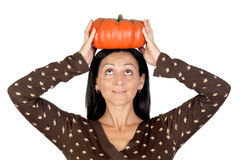 Attractive girl with a big pumpkin Stock Photos