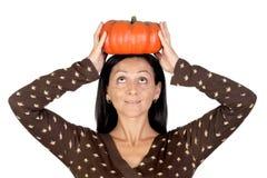 Attractive girl with a big pumpkin Stock Photos
