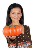 Attractive girl with a big pumpkin Stock Images