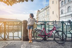 Attractive girl with bike stock photos