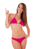 Attractive girl in bikini points with finger Stock Photos