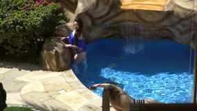 Attractive girl in bikini in pool hot summer day. 120fps. 17.03.2018, Sharm-El-Sheikh, Egypt. Attractive girl in bikini in pool hot summer day stock video