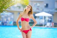 Attractive girl in bikini. Pool royalty free stock images