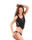 Attractive girl in black bikini with Brazilian flag on her tank top showing her curves. Royalty Free Stock Images