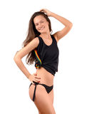 Attractive girl in black bikini and a tank top showing her curves. Royalty Free Stock Images