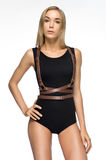 Attractive girl in black bodysuit Stock Image