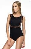 Attractive girl in black bodysuit and sword belt Stock Photos