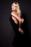 Attractive girl in black dress. Studio shot royalty free stock image