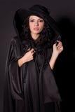 Attractive girl in black hat. Studio shot stock photo