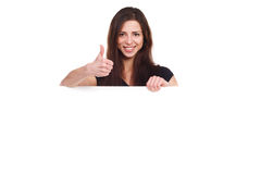Attractive girl with blank ad shows thumb up Royalty Free Stock Photography