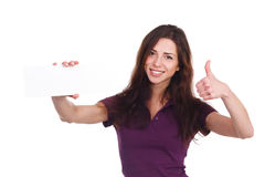 Attractive girl with blank ad shows thumb up Royalty Free Stock Photo