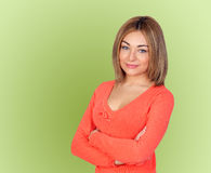 Attractive girl with blond hair. On green background Royalty Free Stock Image