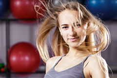 Attractive girl with blonde hair in fitness center Royalty Free Stock Photos