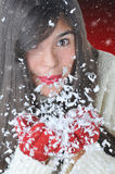 Attractive Girl Blowing Snow Stock Photo