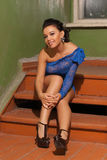 Attractive girl in a blue dress Stock Images