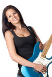 Attractive girl with a blue electric guitar. Isolated on white background Royalty Free Stock Photo