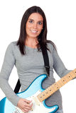 Attractive girl with a blue electric guitar. Isolated on white background Royalty Free Stock Photography