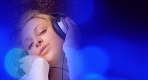 Attractive girl blue music background Stock Photos