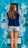 Attractive girl in blue shorts Stock Photo
