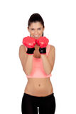 Attractive girl with boxing gloves Royalty Free Stock Images