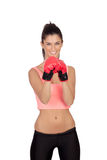 Attractive girl with boxing gloves Stock Photos