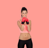 Attractive girl with boxing gloves Royalty Free Stock Image