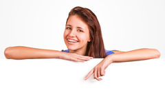Attractive girl with braces presenting empty board Royalty Free Stock Photography