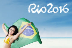 Attractive girl with Brazilian flag on beach Stock Photography