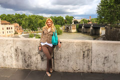 Attractive girl  on the bridge across the Tiber in Rome, Italy Stock Photography