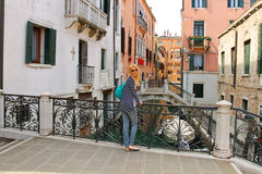 Attractive girl  on a bridge in Venice Royalty Free Stock Image