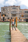Attractive girl  on a bridge in Venice Stock Images