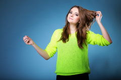Attractive girl in bright vivid colour sweater Royalty Free Stock Photo