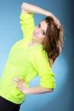 Attractive girl in bright vivid colour sweater Stock Photo
