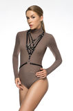 Attractive girl in brown bodysuit Royalty Free Stock Images