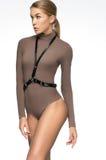 Attractive girl in brown bodysuit and sword belt Stock Photo