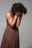 Attractive girl in brown dress cries Stock Photo