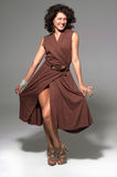 Attractive girl in brown dress Royalty Free Stock Images