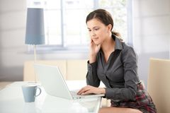 Attractive girl browsing internet at home Stock Photo