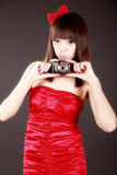 Attractive girl with camera Stock Photography