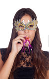 Attractive girl with a carnival mask Stock Photos