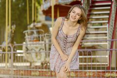 Attractive girl in the carousel park stock images